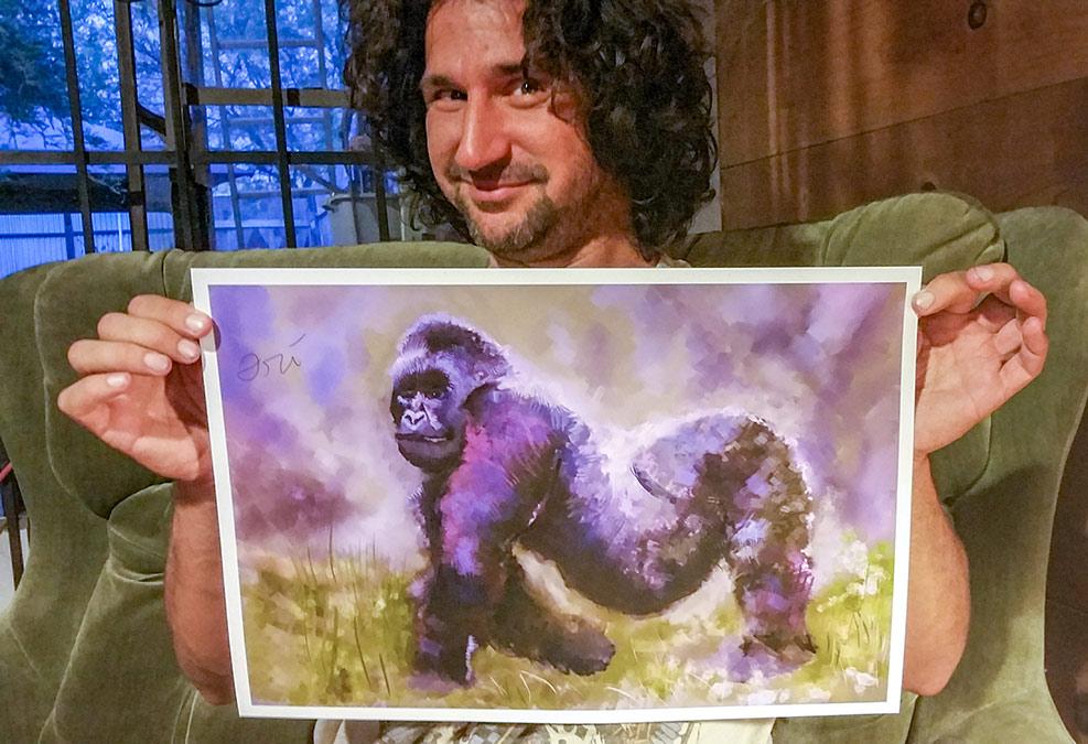 Ori Bengal holding up 12x18 Gorilla painting